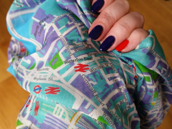 Close up of a blue silk map scarf from Escape!
