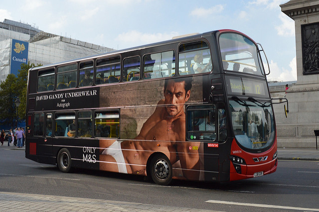 Image of a David Gandy for M&S advert on the side of a London bus.