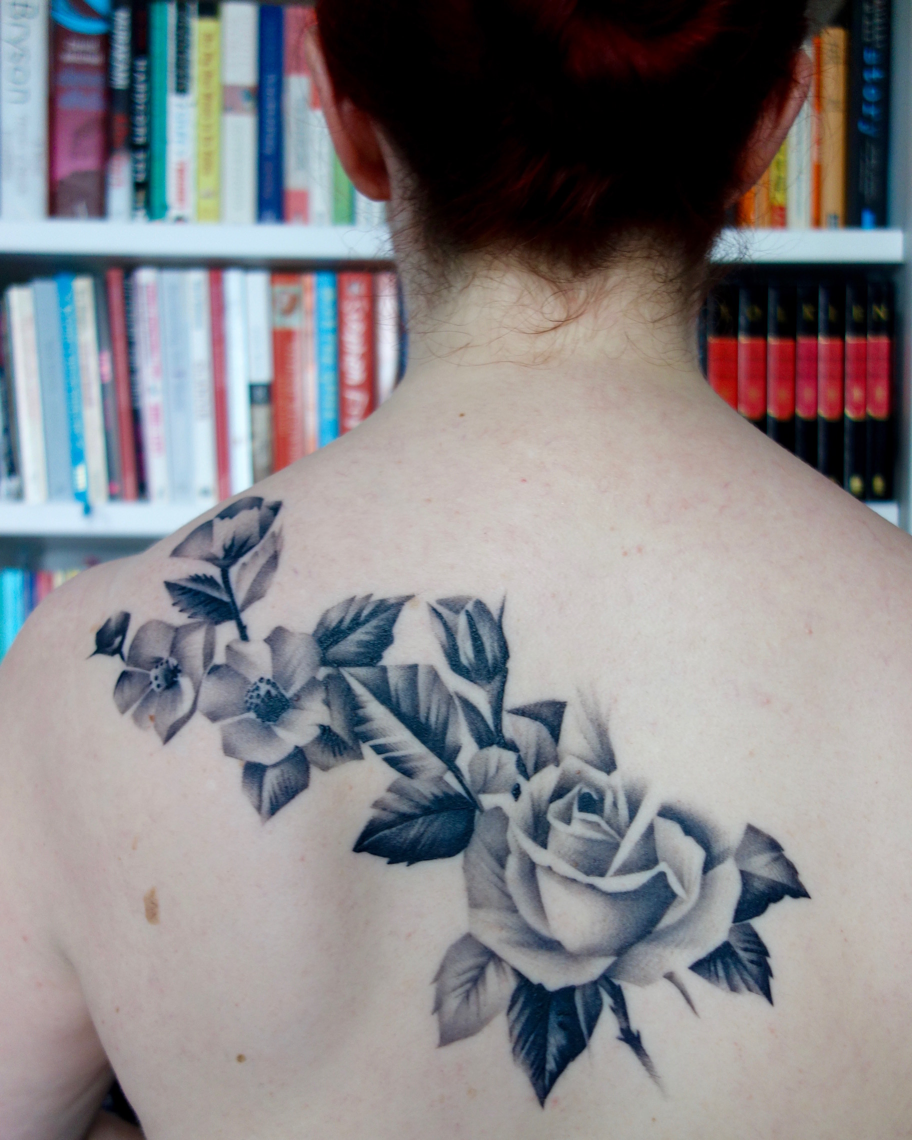 Part 1 of Lori's tattoo. Black & grey roses by Ricky Williams