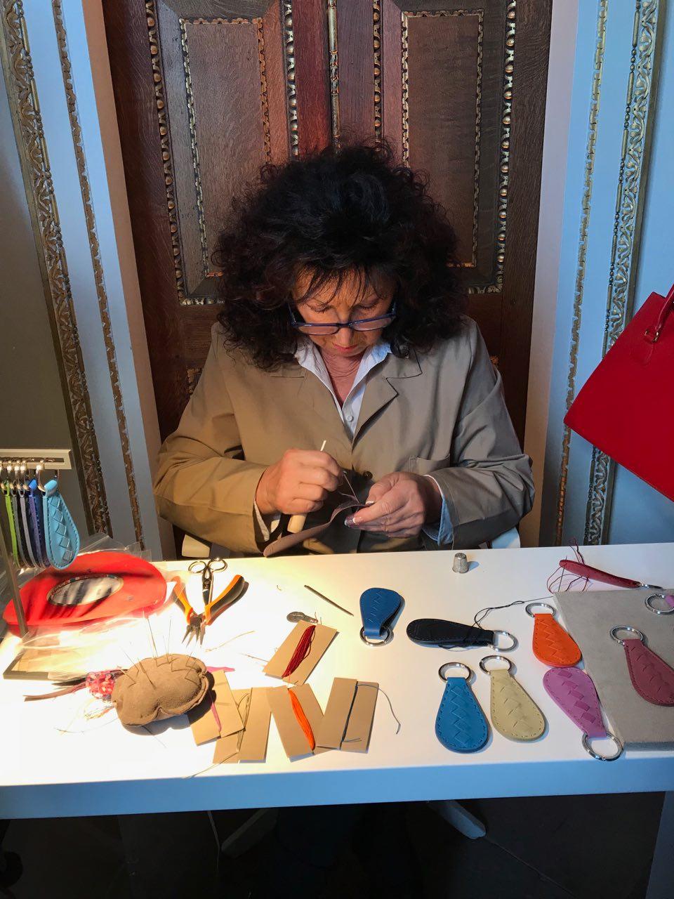 One of the artisans, making Bottega Veneta leather keyrings