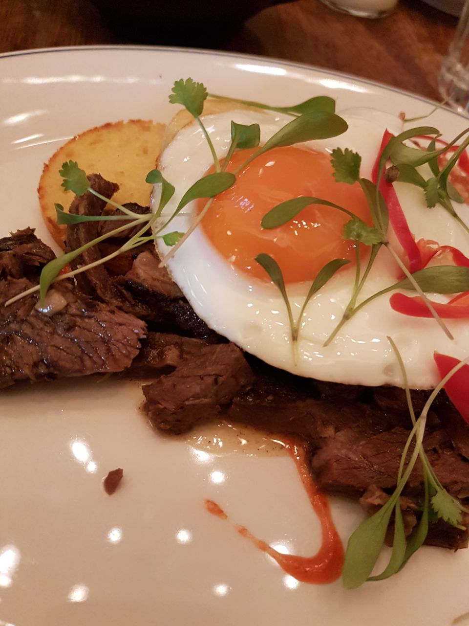 Lou's shortrib on jalapeno cornbread, with cheese and a fried egg.