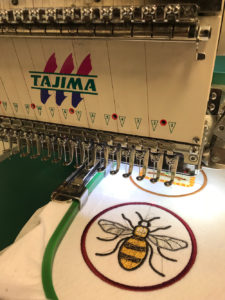Lori's bee patch being stitched at the London Embroidery Studio