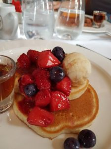 Lou's buttermilk pancakes with berries, honeycomb ice cream and maple syrup