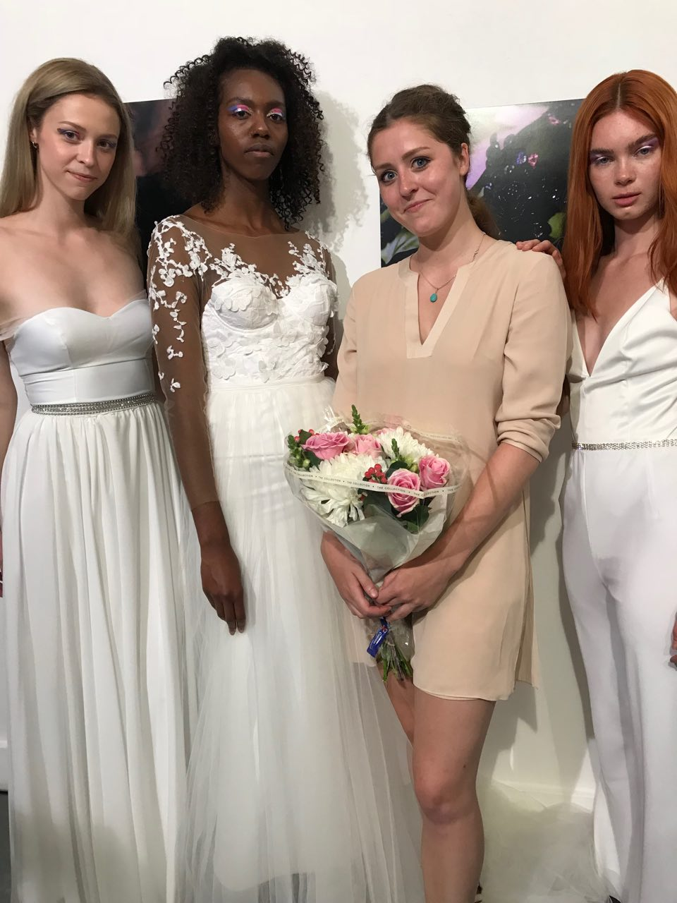 Kristi Kuiken with models wearing bridalwear from her graduate collection