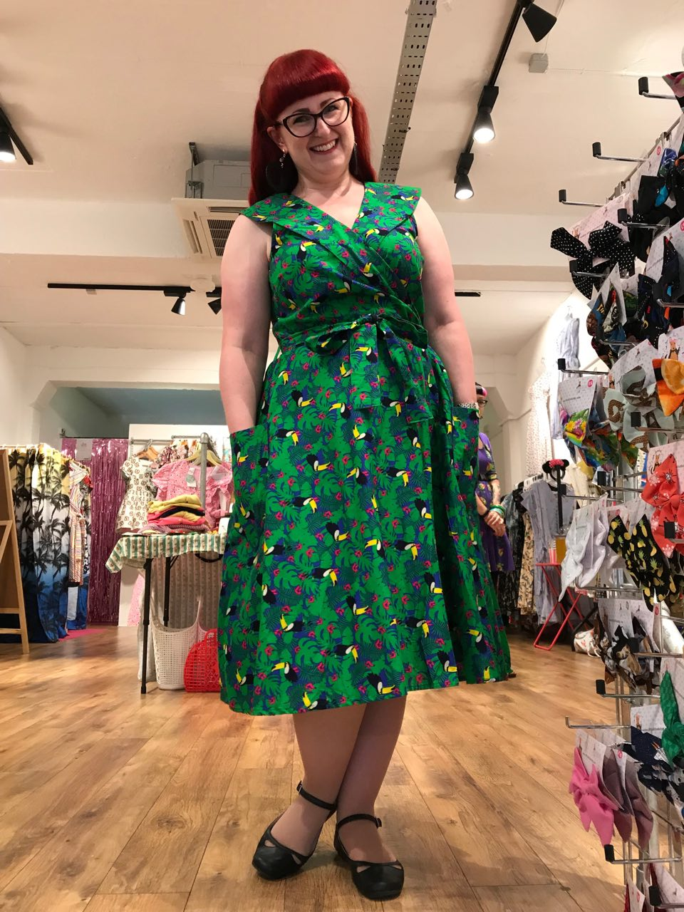 Lori wearing a toucan print dress from Love ur Look