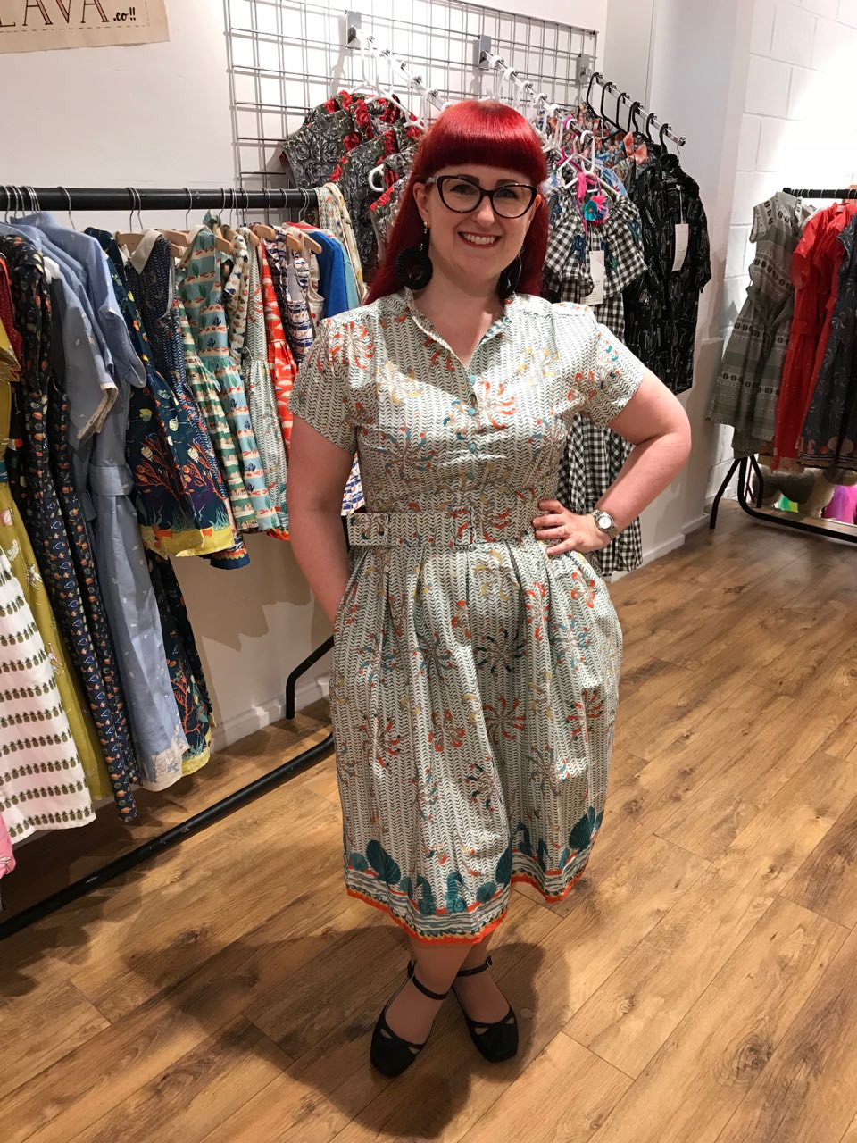 Lori wearing the 'Louise' dress by Palava in the light blue lido print