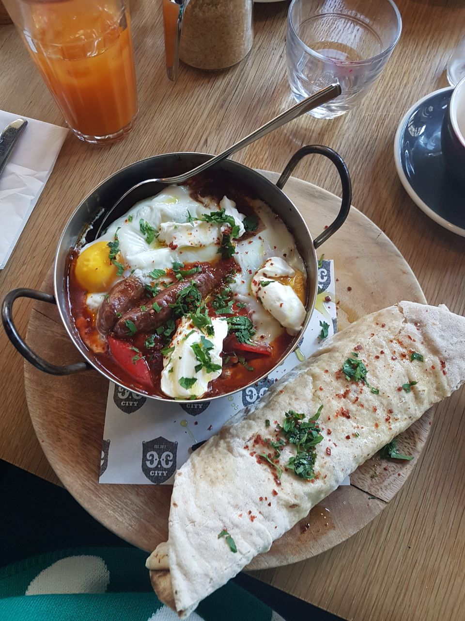 Lou's baked eggs with Mezcal sausage and flatbread at Caravan