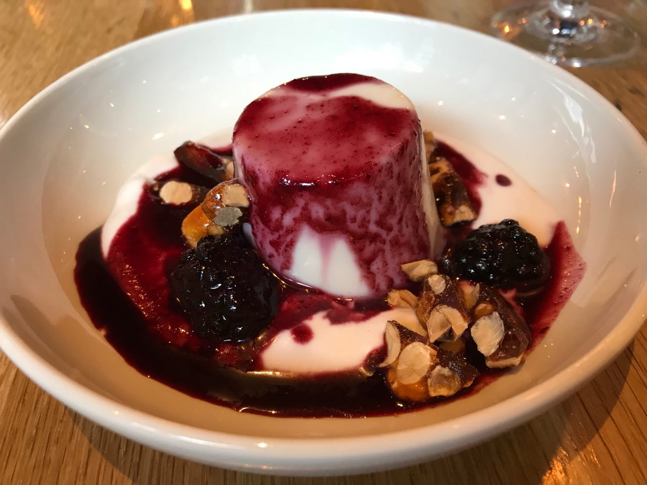 Lori's coconut panna cotta with blackberries and hazelnut brittle